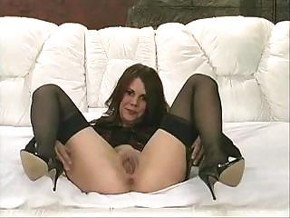 Porno Video of Lovely Middle-aged Whore In Black Stockings Gets Herself Very Horny