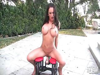 Porno Video of Brunette Is Riding On A Fuck Machine And Holding On Hard For It