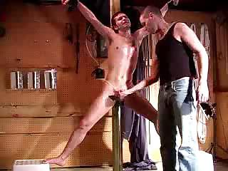 Porno Video of Slave Is Tied Up And His Master Is Playing With His Poor Cock