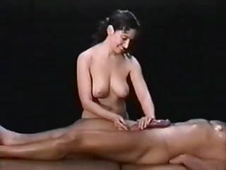 Porn Tube of Babe Is Massaging Him Before Taking Cock In Hand And Pumping