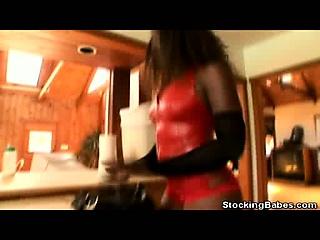 Ebony In Stockings Gives a Foot Job