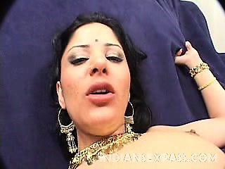 This pretty Indian lady spreading her thighs wide while a