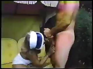Cute tennis playing babe is sucking some cock in a vintage scene