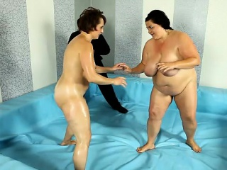 Fighters meet in naked BBW wrestling match