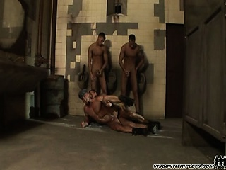 Prison triplets caught by the guard decide to mount his ass
