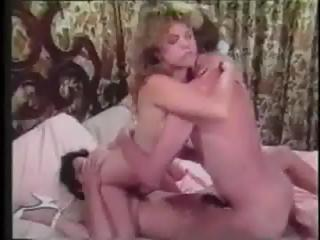 Vintage John Holmes movie where he takes care of two women with his cock