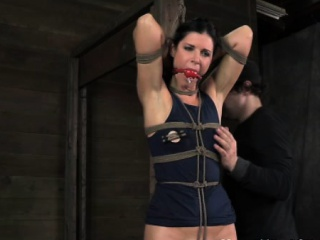 Restained sub has her clothing cut off