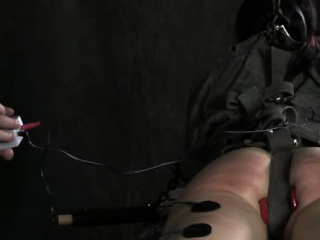 Tied down ball gagged sub electric tormented spanked hard