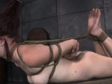 Hogtied sub subjected to bastinado