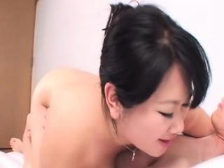 Fat asian giving a big tits massage