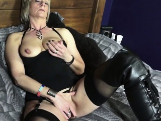 Mature British Woman In Boots Playing...