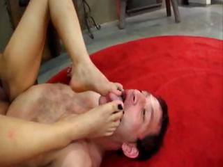 Asian Mistress gets her slave out of his cage to eat her pussy