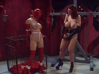 Porn Tube of Busty Babes And One Masked As Mistress Tortures Her Slave