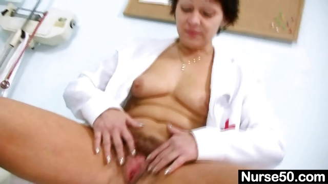 Porno Video of Sexy Milf In Nurse Uniform Stretching Hairy Pussy