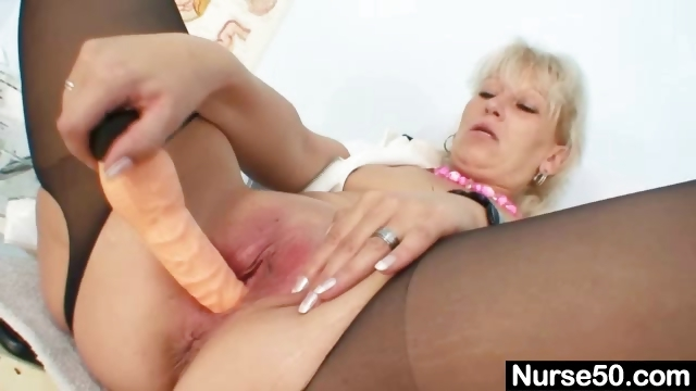 Porn Tube of Blond Milf In Latex Uniform Extreme Dildo Insertion