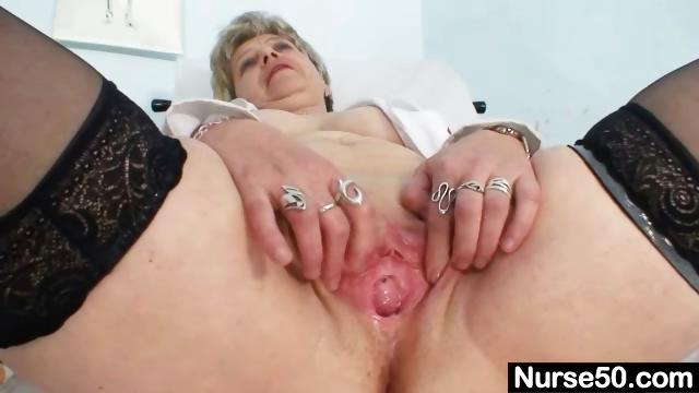 Porno Video of Busty Granny In Uniform Stretching Her Aged Pussy