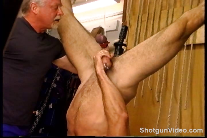 Porno Video of Jim Roberts Suspended Upside Down Stuffed With A Big Dildo And Getting His Testicles Punished.