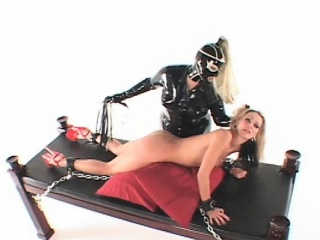 Lesbo mistress working BDSM slaves pussy