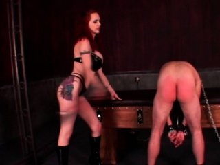 Naked BDSM male slave takes ass spanking