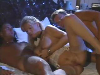 Porno Video of Blonde Babette Blue Takes On Two Cocks And Sucks And Fucks Them Both