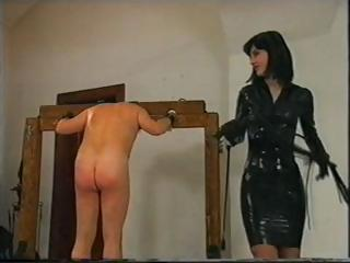 Porn Tube of Dude Is Tied Up And Whipped As His Latex Clad Mistress Abuses Him