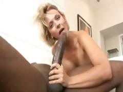 Blonde Brinna Beach takes first of all Mandingo's very large black cock