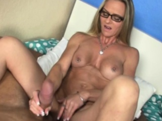 Tugging specs milf with groovy pussy tattoo