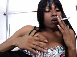 Smoking ebony shemale posing solo closeup