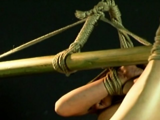 Amateur Asian teen tied up and hung on a tube