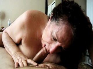 Lusty granny enjoys stiff cock in her mouth...
