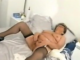 Chubby granny with glasses masturbates...
