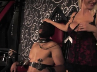 Busty bdsm mistress in lingerie and her slave