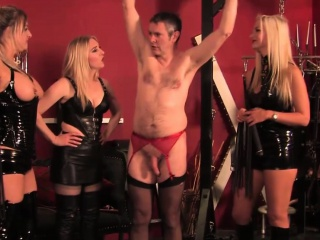 Teasing Topless Femdoms Flogging Sub...