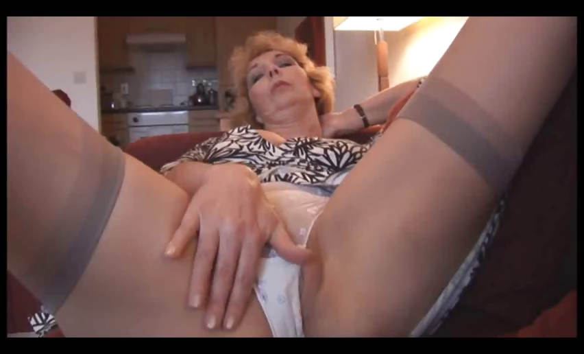 Porno Video of Attractive Mature Milf In Stockings Strips And Shows Off Shaved Pussy