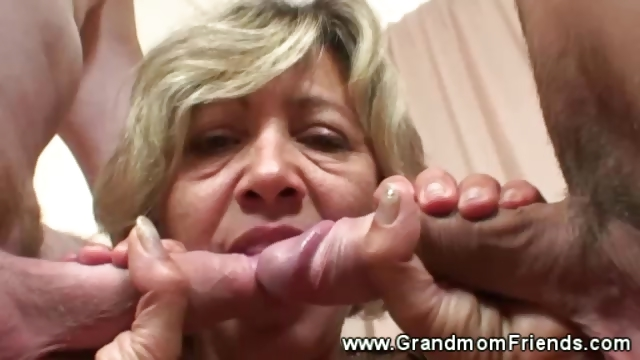 Porno Video of Sexy Granny Sucks And Tugs Two Cocks