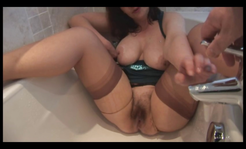 Porno Video of Busty Hairy Mature Babe In Pantyhose Gets Her Clothes Wet