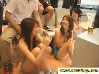 Asian chicks in a bowling alley get naked in this weird party