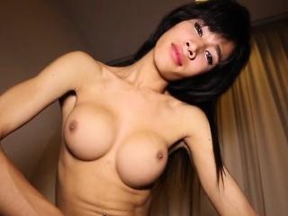 Busty asian shemale tugging her cock closeup