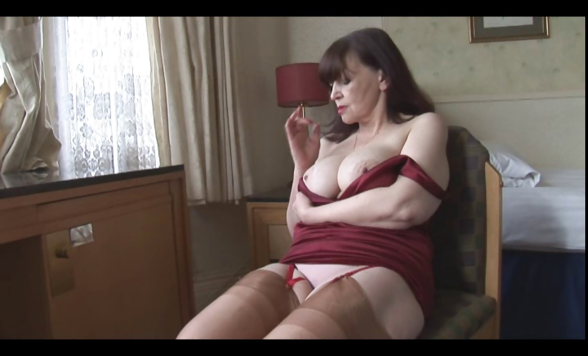 Porn Tube of Big Tits Mature Milf Shows Off Sheer Panties Stockings And Cleavage Then Slowly Strips And Spreads