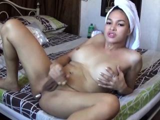 Shemale masturbates after she took a bath