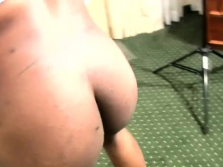 Ebony shemale shakes big ass and covers shecock with lotion