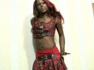 Redhead ebony shemale in skimpy mini skirt sucks cock in POV