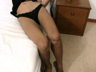Long haired ladyboy in black lingerie sucks massive dick