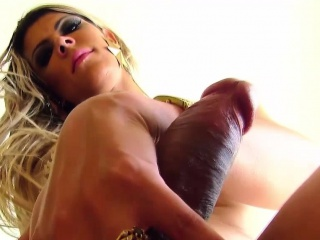 Busty tgirl jerking bigcock while in heels