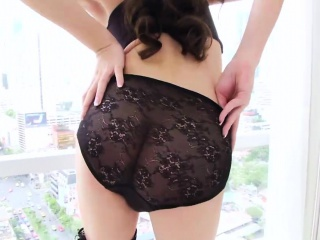 Asian shemale cutie spreads her legs and takes a fat dick