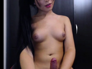 Asian Transsexual strokes her cock on Cam