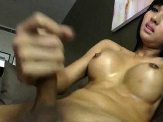 Brunette Asian shemale masturbates and cums.