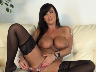 stacked brunette cougar lisa ann pleases her peach with a glass dildo