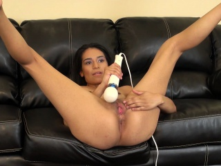 sexy slim brunette zaydyn gordon plays with a vibrator on the couch