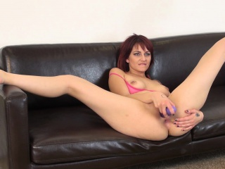 kinky redhead phoenix askani spreads her legs and pleases her snatch